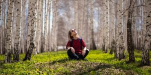 Woman sitting outside in nature
