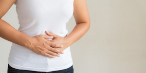Woman holding her gut